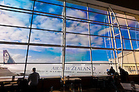 Looking through a massive glass window at an Air New Zealand 747, Auckland Airport, Auckland, New Zealand