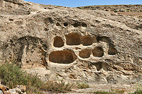 Picture &amp; image of Uplistsikhe (Lords Fortress) troglodyte cave city, house stone shelves, near Gori, Shida Kartli, Georgia. UNESCO World Heritage Tentative List<br /> <br /> Inhabited from the early Iron age to the late middle ages Uplistsikhe cave city eas, during the Roman &amp; Hellenistic period, home to around 20,000 people.