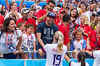 LYON,  - JULY 7: Allie Long #20 celebrates with her husband during a game between Netherlands and USWNT at Stade de Lyon on July 7, 2019 in Lyon, France.