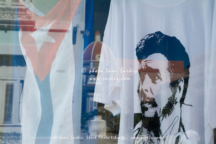 Che Guevara T-shirt and Cuban flag in a store window, Cienfuegos, Cuba.