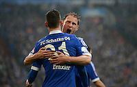FUSSBALL   1. BUNDESLIGA   SAISON 2012/2013    25. SPIELTAG FC Schalke 04 - Borussia Dortmund                         09.03.2013 Julian Draxler (li) bejubelt mit Benedikt Hoewedes (re, beide FC Schalke 04) sein Tor zum 1:0