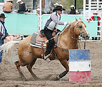 Susie Luschar-Clymo from Carson City competes in Ladies Barrel racing 40-50 division.