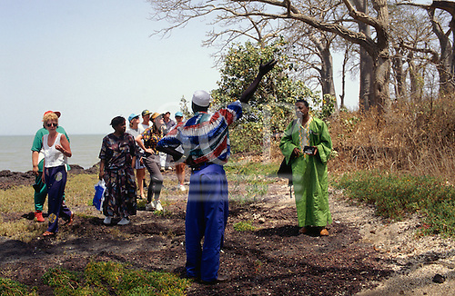 The Gambia. Local guide talking to a group of tourists on an ecotour.