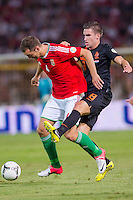 Hungary's Roland Juhasz (L) and Netherlands' Kevin Strootman (R) fight for the ball during a World Cup 2014 qualifying soccer match Hungary playing against Netherlands in Budapest, Hungary on September 11, 2012. ATTILA VOLGYI