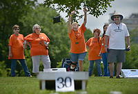 NWA Democrat-Gazette/BEN GOFF @NWABENGOFF<br /> Dr. Angela Rose (center), practices her throw as her 'Feline Fine' teammates from The Cat Clinic of Northwest Arkansas watch Friday, June 16, 2017, during the Catfish, Corndogs and Cornhole tournament at Mercy Hospital in Rogers. The event is an annual fundraiser hosted by WhyteSpyder, whith proceeds from this year's tournament benefiting Mercy Health Foundation. Some 140 teams of two entered this year, according to WhyteSpyder CEO Eric Howerton.
