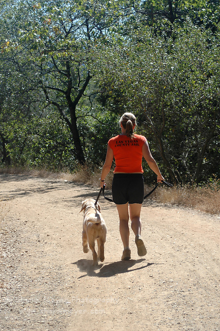Woman running with her dog on Stagecoach Trail