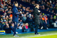 29th December 2019; The Hawthorns, West Bromwich, West Midlands, England; English Championship Football, West Bromwich Albion versus Middlesbrough; Middlesbrough Manager Jonathan Woodgate watches play from his technical area with West Bromwich Albion Head Coach Slaven Bilic in the background - Strictly Editorial Use Only. No use with unauthorized audio, video, data, fixture lists, club/league logos or 'live' services. Online in-match use limited to 120 images, no video emulation. No use in betting, games or single club/league/player publications