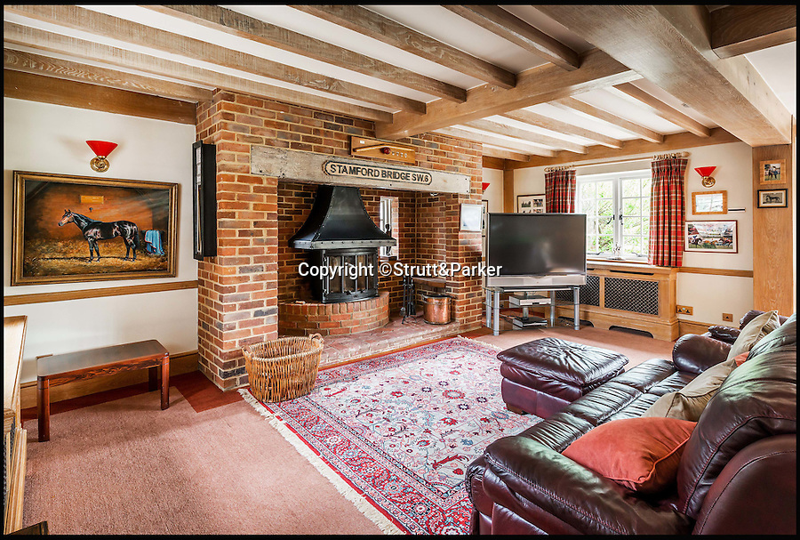 BNPS.co.uk (01202 558833)<br /> Pic: Strutt&Parker/BNPS<br /> <br /> A sure bet...<br /> <br /> Embrace all things equestrian with this stunning country house and stud farm that was once home to a Grand National winner.<br /> <br /> Crimbourne Stud in Billingshurst, West Sussex, has everything a horse-lover could want or need but would also appeal to anyone looking for a new life in the country.<br /> <br /> The impressive estate was the home of Sir Eric Parker, a well-known and respected racehorse owner and breeder, who won the Grand National in 1991 with his horse Seagram.<br /> <br /> The 48-acre estate which includes a 15th century farmhouse, five other properties, an indoor swimming pool, sauna and tennis court, plus the stable yard is now on the market with Strutt & Parker for £4.95million.