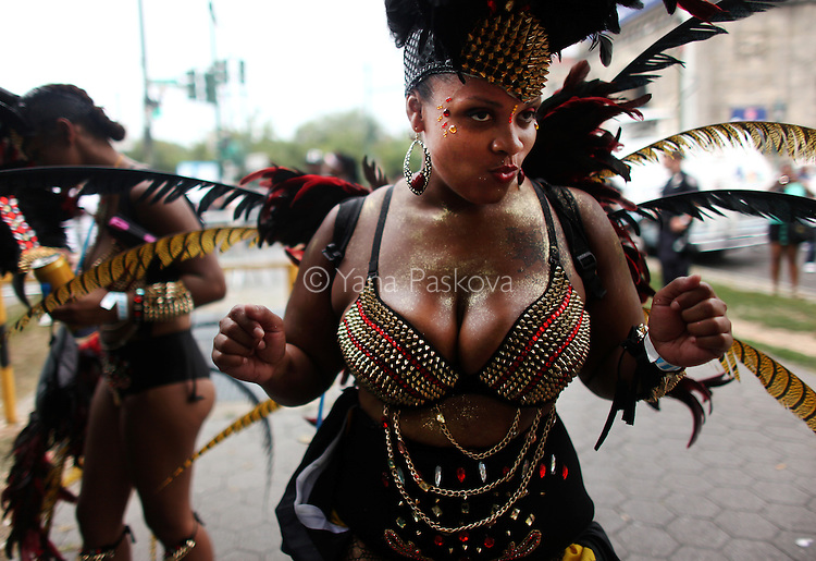 A costumed dancer prepares to participate in the 46th annual West Indian parade on Labor Day on Monday, September 02, 2013, in Brooklyn, New York. (Photo by Yana Paskova for The Cut/New York magazine)