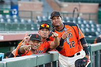 AZL Giants Andres Angulo (1), Ricardo Genoves (15), and Beicker Mendoza (12) hang out in the dugout prior to a game against the AZL Rangers on August 22 at Scottsdale Stadium in Scottsdale, Arizona. AZL Rangers defeated the AZL Giants 7-5. (Zachary Lucy/Four Seam Images via AP Images)