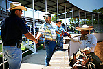 Checo Galindo Sr., right, greets guests to his Lienzo before the beginning of the Charreada in San Antonio, Texas on Sunday, August 3, 2008. Charreada, a Mexican rodeo, is a 400 year old Mexican tradition that combines ranch work sports with stylish outfits and traditions of generations of families. (Benjamin Sklar for ESPN the Magazine)