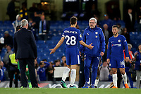 Chelsea's Cesar Azpilicueta looks to be asking Fitness Coach, Paolo Bertelli what is happening regarding the traditional walk around the pitch at the end of the last home game of the season during Chelsea vs Huddersfield Town, Premier League Football at Stamford Bridge on 9th May 2018