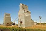Old metal grain elevators along the railroad track