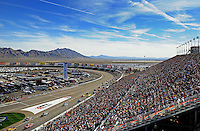 Mar. 1, 2009; Las Vegas, NV, USA; NASCAR Sprint Cup Series drivers head into turn one during the Shelby 427 at Las Vegas Motor Speedway. Mandatory Credit: Mark J. Rebilas-