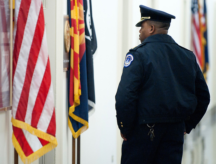 UNITED STATES - JANUARY 8: U.S. Capitol Police stand guard outside of Rep. Gabrielle Giffords' Capitol Hill office in the Longworth House Office Building after the congresswoman was shot in her home district in Tucson, Ariz., on Saturday, Jan. 8, 2011.  (Photo By Bill Clark/Roll Call)