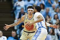 CHAPEL HILL, NC - JANUARY 4: Jordan Usher #4 of Georgia Tech defends the ball during a game between Georgia Tech and North Carolina at Dean E. Smith Center on January 4, 2020 in Chapel Hill, North Carolina.