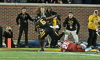 NWA Media/Michael Woods --11/28/2014-- w @NWAMICHAELW...Missouri running back Marcus Murphy slips past Arkansas defender Rohan Gaines to score the go ahead touchdown in the the 4th quarter of Friday afternoons game against Missouri at Faurot Field in Columbia Missouri.