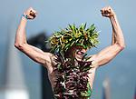 KAILUA-KONA, HI - OCTOBER 13:  Pete Jacobs of Australia crosses the finish line to win the 2012 IRONMAN World Championships on October 13, 2012 in Kailua-Kona, Hawaii. (Photo by Donald Miralle)