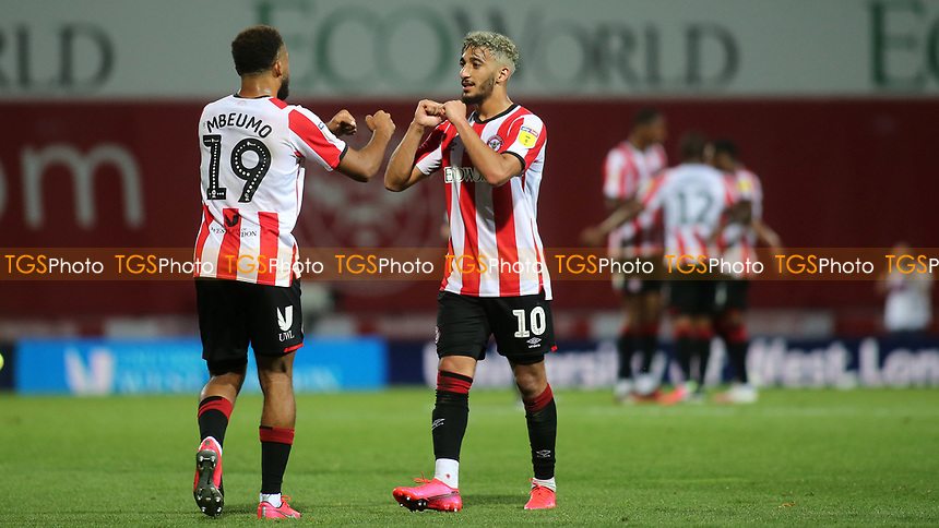 Bryan Mbeumo and Said Benrahma celebrate Brentford's victory at the final whistle during Brentford vs West Bromwich Albion, Sky Bet EFL Championship Football at Griffin Park on 26th June 2020