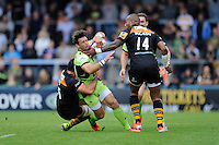 Ben Foden of Northampton Saints is tackled by Andrea Masi and Tom Varndell of Wasps during the Premiership Rugby Round 2 match between Wasps and Northampton Saints at Adams Park on Sunday 14th September 2014 (Photo by Rob Munro)