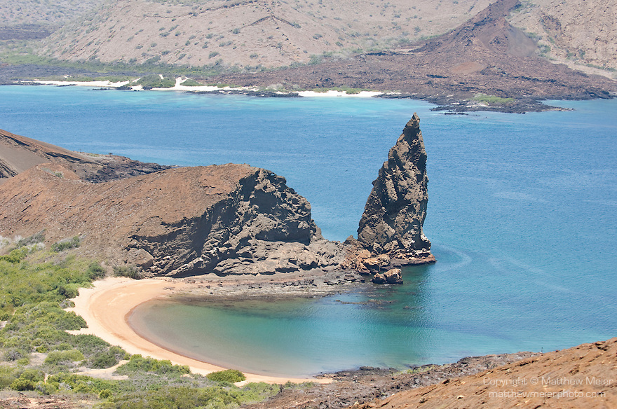 Bartolome Island, Galapagos, Ecuador; Pinnacle Rock, James Bay and Santiago Island viewed from the path leading to the summit of Bartolome Island , Copyright © Matthew Meier, matthewmeierphoto.com All Rights Reserved