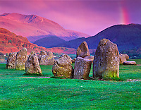 Castlerigg Stone Circle Lake District National Park with rainbow, England Neolithic standing stones Mountains of Lake District beyond  May