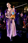 Japanese violinist Emiri Miyamoto shows the ''Tsunami Violin'' during the 1000 Days to Go! cultural event in front of Tokyo Station on November 26, 2017, Tokyo, Japan. Japanese celebrities attended the event marking the 1000-day countdown to the 2020 Tokyo Olympics. (Photo by Rodrigo Reyes Marin/AFLO)