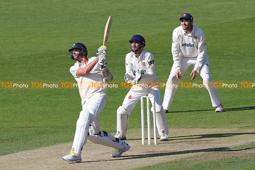 Michael Hogan of Glamorgan hits out as James Foster looks on from behind the stumps - Glamorgan CCC vs Essex CCC - LV County Championship Division Two Cricket at the SWALEC Stadium, Sophia Gardens, Cardiff, Wales - 20/05/15 - MANDATORY CREDIT: TGSPHOTO - Self billing applies where appropriate - contact@tgsphoto.co.uk - NO UNPAID USE