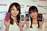 February 1, 2012, Tokyo, Japan - .Models show Docomo's new smartphone F-08D and P-05D during a news conference in Tokyo on Wednesday,  February 1, 2012. NTT Docomo and Walt Disney have jointly announces they will introduce new smartphone the 'Disney Mobile on docomo'. The smartphone offers exclusive benefits, services and content that allow users to have a unique Disney experience..(Photo by Koichi Mitsui/AFLO).
