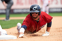 Columbus Clippers outfielder Tyler Holt (15) dives back to first on a pickoff attempt during a game against the Buffalo Bisons on July 19, 2015 at Coca-Cola Field in Buffalo, New York.  Buffalo defeated Columbus 4-3 in twelve innings.  (Mike Janes/Four Seam Images)
