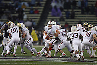 Oct 30, 20010:  Stanford quarterback #12 Andrew Luck sets up to hand the ball off to running back #33 Stepfen Taylor during the second half against Washington.  Stanford defeated Washington 41-0 at Husky Stadium in Seattle, Washington...