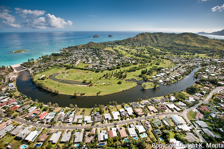 Aerial view of the Mid-Pacific Golf Course and Lanikai from the skies over residential Kailua. Flat Island and Kailua Beach is to the left and the Mokulua Islands are in the background.