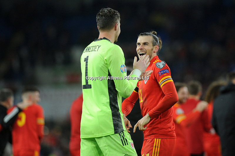 Wayne Hennessey and Gareth Bale of Wales celebrate at full time during the UEFA Euro 2020 Group E Qualifier match between Wales and Hungary at the Cardiff City Stadium in Cardiff, Wales, UK. Tuesday 19th November 2019