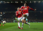 Chris Smalling and Marouane Fellaini of Manchester United collide trying to keep the ball in play during the UEFA Europa League match at Old Trafford. Photo credit should read: Philip Oldham/Sportimage