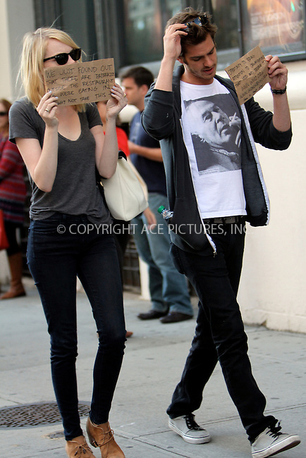 WWW.ACEPIXS.COM....September 15 2012, New York City....Actors Emma Stone and Andrew Garfield hold their own protest in Soho on September 15 2012 in New York City......By Line: Nancy Rivera/ACE Pictures......ACE Pictures, Inc...tel: 646 769 0430..Email: info@acepixs.com..www.acepixs.com