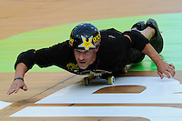 17 August, 2012:  Danny Mayer slides on his board during the Semi-final of Skateboard Vert at the Pantech Beach Championships in Ocean City, MD.  Danny was injured during a practice run and had difficulty competing and walking