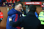 Louis Van Gaal, manager of Manchester United greets Quique Flores, manager of Watford - Barclay's Premier League - Manchester United vs Watford - Old Trafford - Manchester - 02/03/2016 Pic Philip Oldham/SportImage