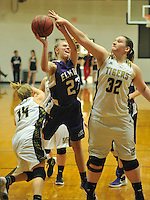 NWA Democrat-Gazette/MICHAEL WOODS • @NWAMICHAELW<br /> Elkins Kenadie Kestner (23) is fouled by WestFork defender Holly Griffin (32) as she drives to the hoop Tuesday, February 2, 2016 during their game in West Fork.