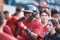 AZL D-backs Neyfy Castillo (17) is congratulated by teammates after hitting a home run during an Arizona League game against the AZL Cubs 1 on July 25, 2019 at Sloan Park in Mesa, Arizona. The AZL D-backs defeated the AZL Cubs 1 3-2. (Zachary Lucy/Four Seam Images)