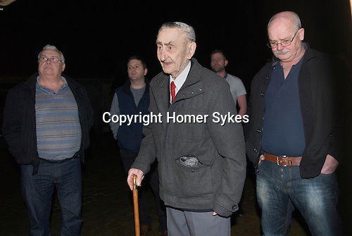"""Bill Richards (91 yrs) leads a group of Wassailers who travel around the village of Curry Rivel Somerset on old New Years Eve, January 5th. Bill Richardson bidding the house holders """"... and a happy New Year"""", before being invited in for refreshment.   UK 2016"""