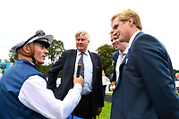 Jockey Andrea Atzeni talks to connections of Cap Francais in the winners enclosure after winning The Gift Of Sight Appeal EBF Novice Stakes Div 1 during the Bathwick Tyres & EBF Race Day at Salisbury Racecourse on 6th September 2018