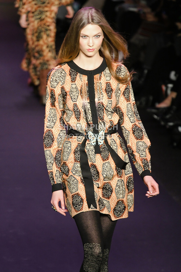 Karlie Kloss walks runway in an outfit from the Anna Sui Fall 2011 collection, during Mercedes-Benz Fashion Week Fall 2011.