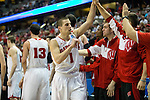 Wisconsin Badgers Ben Brust (1) celebrates with teammates during a regional semifinal NCAA college basketball tournament game against the Baylor Bears Thursday, March 27, 2014 in Anaheim, California. The Badgers won 69-52. (Photo by David Stluka)