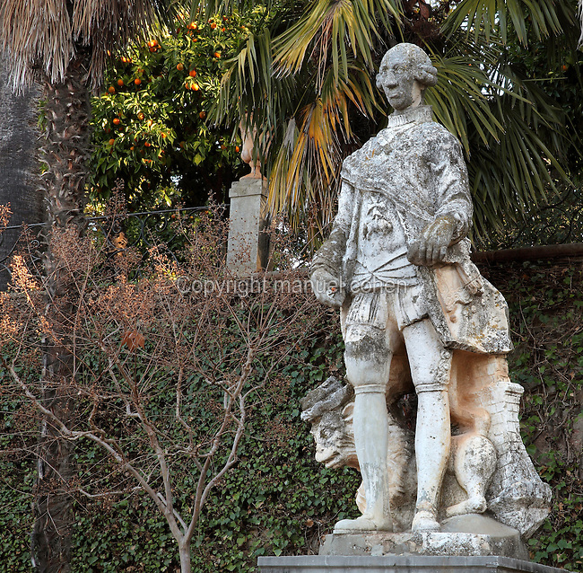 Statue of Carlos III or King Charles III of Spain, 1716-88, on the terrace outside the main building of the Carmen de los Martires Garden, on the site of a Barefoot Carmelite shrine and convent originally established in 1492, in Granada, Andalusia, Southern Spain. A Carmen is a traditional house with enclosed garden, this example dates to the 19th century and displays various garden styles including English, Spanish and Nasrid. Picture by Manuel Cohen