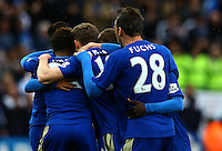 Marc Albrighton of Leicester City is mobbed by team mates after scoring a goal to make it 4-0 during the Barclays Premier League match between Leicester City and Swansea City played at The King Power Stadium, Leicester on 24th April 2016