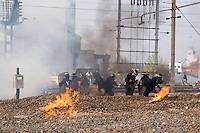 Fighting between Police and Anarchists of the railway line near Gare des Ports after the anti NATO demonstration.