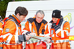 Irish Coast guard Chris Muijzert, Brendan Hehir, Richard Spencer and Kris Kjelsen surveying the map at the Kerry Mountain Rescue emergency exercise drill at Torc Killarney on Saturday