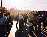 TURKEY, Istanbul, large group of people walking on street with Yeni Camii Mosque in the background