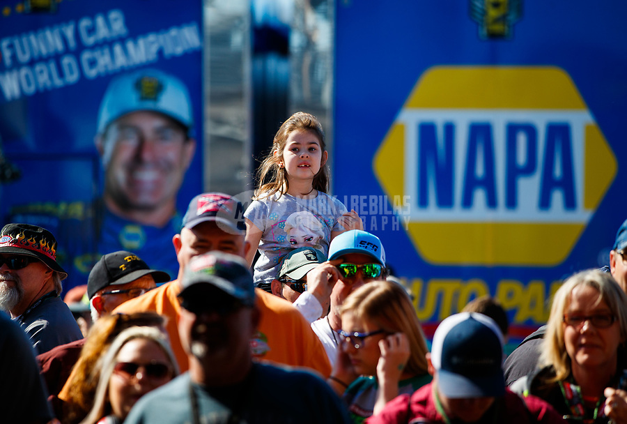 Mar 18, 2017; Gainesville , FL, USA; A young female fan in the NHRA pits as a car warms up during qualifying for the Gatornationals at Gainesville Raceway. Mandatory Credit: Mark J. Rebilas-USA TODAY Sports