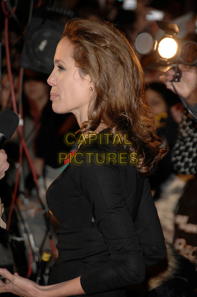 "ANGELINA JOLIE.has stepped in chewing gum..""Beowulf"" European film premiere.Vue cinema, Leicester Square, London, England.11th November 2007.profile half length black top .CAP/PL.©Phil Loftus/Capital Pictures"